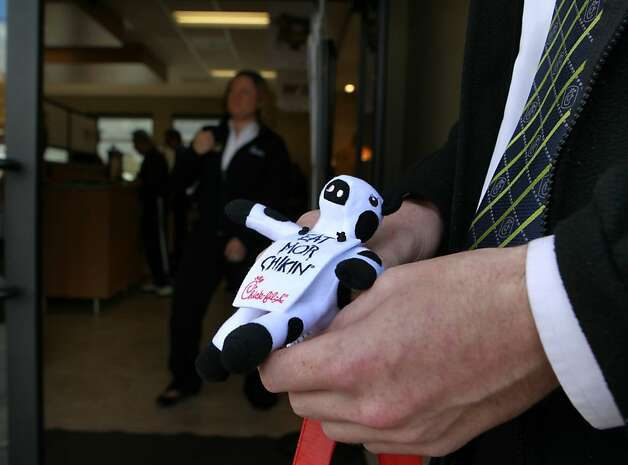 The mascot cow was given away to diners attending the grand opening of a new Chick-fil-A restaurant in Walnut Creek, Calif. on Thursday, Nov. 8, 2012. More than a dozen gay rights activists were also on hand to protest the opening. Photo: Paul Chinn, The Chronicle
