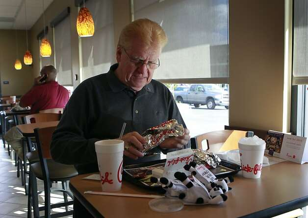 Ron Benham has lunch at the new Chick-fil-A restaurant in Walnut Creek, Calif. on Thursday, Nov. 8, 2012. More than a dozen gay rights activists were on hand protest the grand opening the restaurant. Photo: Paul Chinn, The Chronicle
