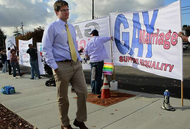 Brent Allen, owner and operator of the new Chick-fil-A franchise, walks past gay rights activists protesting the grand opening of his restaurant in Walnut Creek, Calif. on Thursday, Nov. 8, 2012. Photo: Paul Chinn, The Chronicle