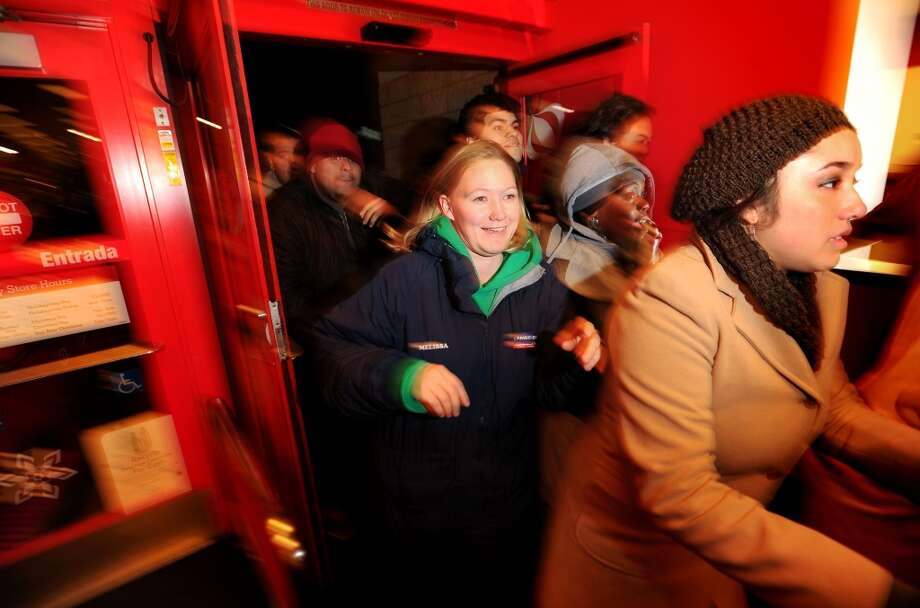 Shoppers rush into a San Leandro, Calif., Target store during its 4 a.m. Black Friday opening on Friday, Nov. 26, 2010. (Noah Berger / Special to The Chronicle)