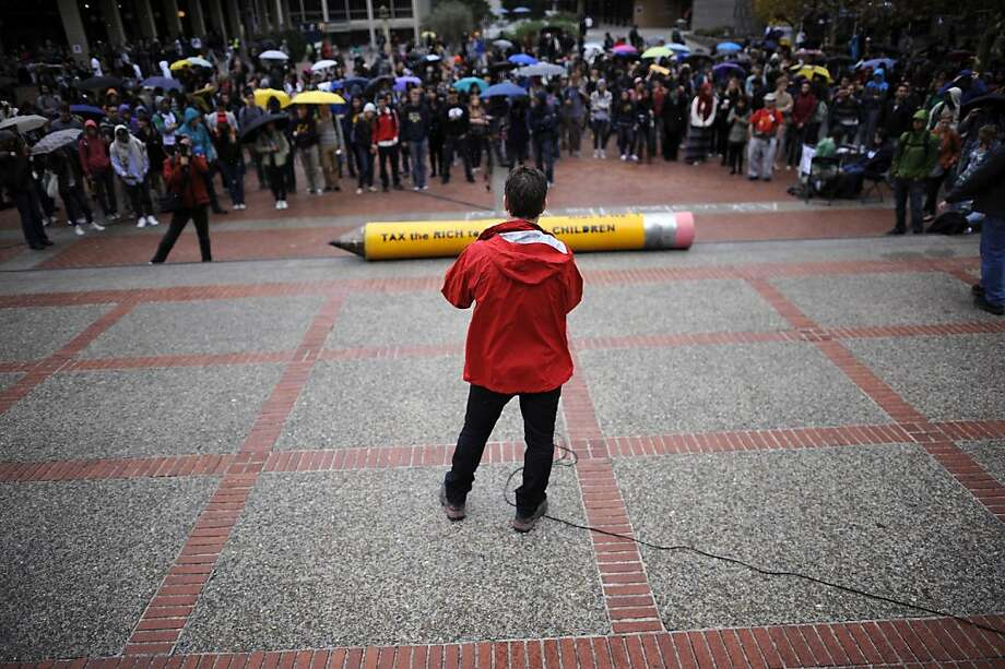"""Demonstrators at UC Berkeley's Sproul Plaza make their point with a giant No. 2 pencil that reads """"Kids R No. 1."""" Photo: Michael Short, Special To The Chronicle"""