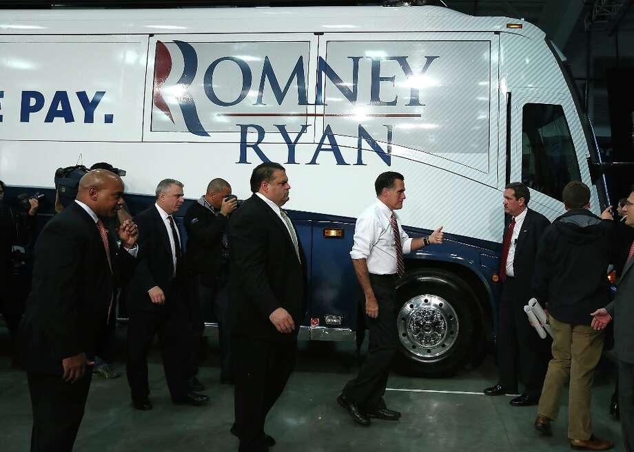 DOSWELL, VA - NOVEMBER 01:  U.S. Secret Service agents surround Republican presidential candidate, former Massachusetts Gov. Mitt Romney as he preapres to board his campaign bus at the conclusion of a campaign event at Meadow Event Park on November 1, 2012 in Doswell, Virginia. With less than one week to go until election day, Romney is campaigning in Virginia.  (Photo by Justin Sullivan/Getty Images) Photo: Justin Sullivan, Getty Images / 2012 Getty Images