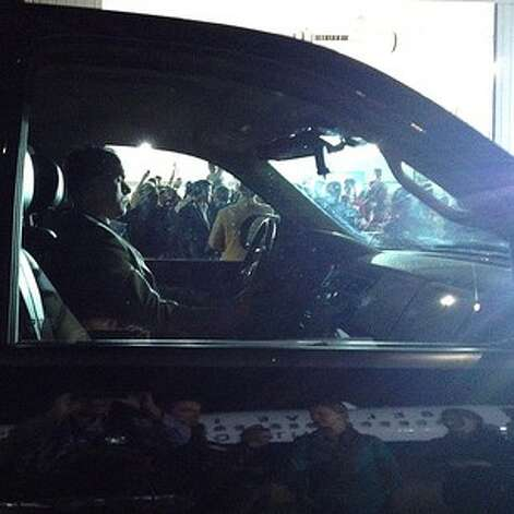 US Secret Service agent shadows Mitt Romney with his armored SUV as he works a ropeline of supporters at an airplane hangar in Cedar Rapids, Iowa #aponthetrail (AP Photo/Charles Dharapak) Photo: Charles Dharapak, Associated Press / AP