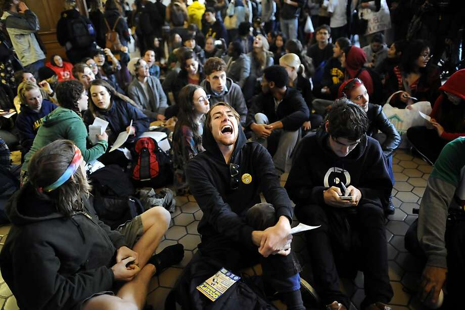 3rd year student Daniel Norton Luna chant along with the crowd as they gather in Wheeler Hall to discuss how to move forward with a list of demands for the UC Regents.  Berkeley and other UC campuses staged a walkout to push for using Prop 30 and other funds to immediately roll back tuition and cuts, on the Cal campus in Berkeley, CA, November 8th, 2012. Photo: Michael Short, Special To The Chronicle
