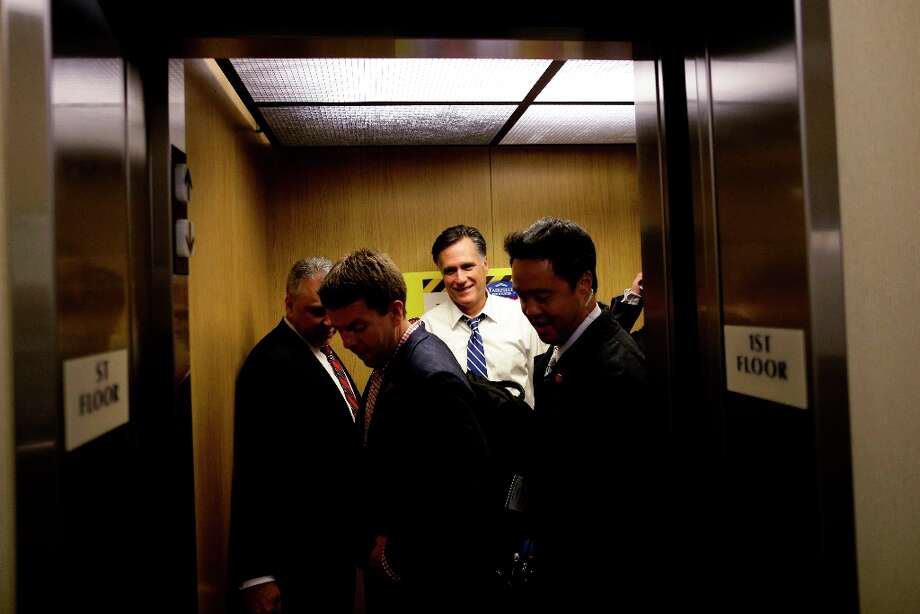Republican presidential candidate and former Massachusetts Gov. Mitt Romney, aide Garret Jackson, second left, and U.S. Secret Service agents get into an elevator as they arrive at their hotel for the evening in Mansfield, Ohio, Sunday, Oct. 28, 2012. (AP Photo/Charles Dharapak) Photo: Charles Dharapak, Associated Press / AP