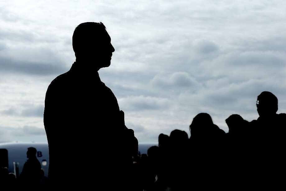 DUBUQUE, IA - NOVEMBER 03:  U.S. Secret Service agents monitor the crowd as Republican presidential candidate, former Massachusetts Gov. Mitt Romney speaks during a campaign rally at Dubuque Jet Center on November 3, 2012 in Dubuque, Iowa. With less than a week before election day, Romney is campaigning in battleground states across the country.  (Photo by Justin Sullivan/Getty Images) Photo: Justin Sullivan, Getty Images / 2012 Getty Images