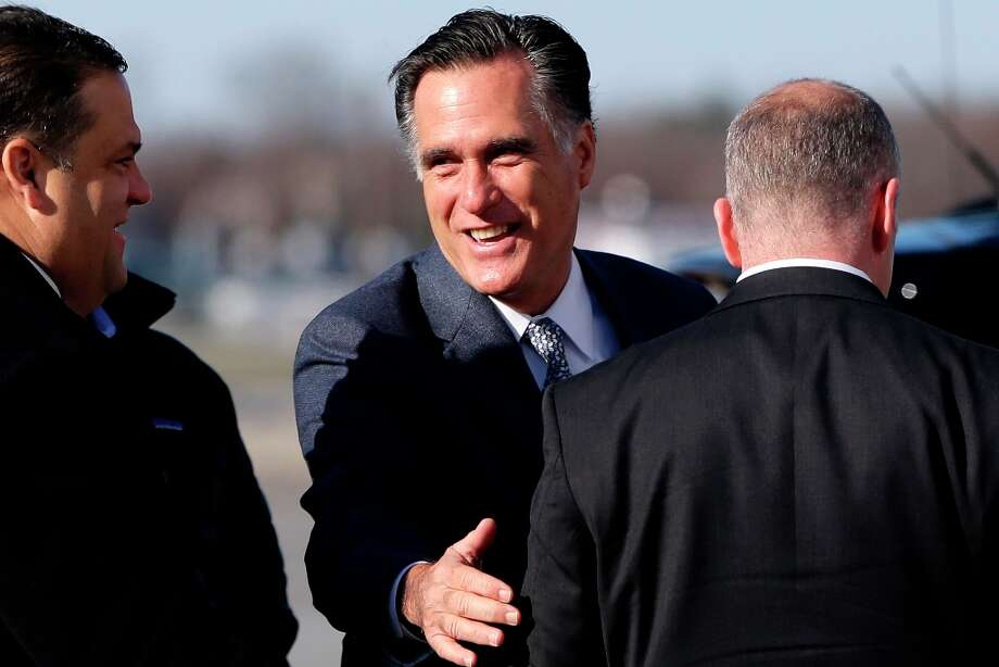 Republican presidential candidate, former Massachusetts Gov. Mitt Romney smiles as he speaks to a U.S. Secret Service agent before boarding his plane in Bedford Mass., for Cleveland, Ohio, Tuesday, Nov. 6, 2012. (AP Photo/Charles Dharapak) Photo: Charles Dharapak, Associated Press / AP