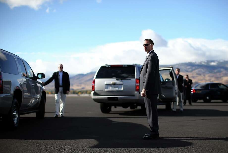 RENO, NV - OCTOBER 24:  U.S. Secret Service agents wait for Republican presidential candidate, former Massachusetts Gov. Mitt Romney to walk off of his campaign plane on October 24, 2012 in Reno, Nevada. Mitt Romney is campaigning in Nevada, Iowa and Ohio.  (Photo by Justin Sullivan/Getty Images) Photo: Justin Sullivan, Getty Images / 2012 Getty Images