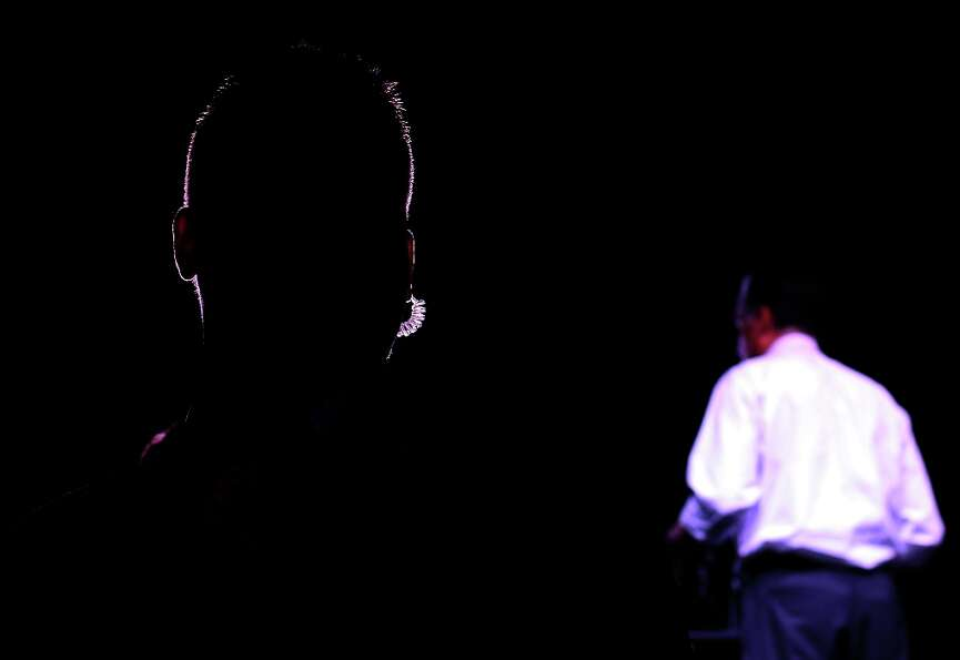RENO, NV - OCTOBER 24:  A U.S. Secret Service agent is silhouetted by stage lights as Republican pre