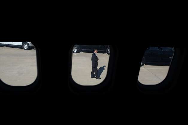 MOLINE, IL - OCTOBER 29:  A U.S. Secret Service agent stands on the tarmac as the campaign plane of Republican presidential candidate, former Massachusetts Gov. Mitt Romney lands at Quad Cities International Airport on October 29, 2012 in Moline, Illinois. Romney has canceled other campaign events on October 29 and 30 due to Hurricane Sandy.  (Photo by Justin Sullivan/Getty Images) Photo: Justin Sullivan, Getty Images / 2012 Getty Images