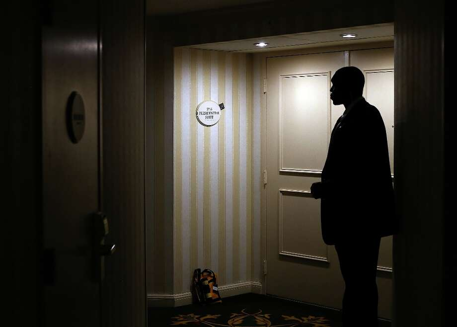 NORFOLK, VA - NOVEMBER 02:  A U.S. Secret Service agent stands guard in front of the hotel room of Republican presidential candidate, former Massachusetts Gov. Mitt Romney on November 2, 2012 in Norfolk, Virginia. With less than one week to go before election day, Mitt Romney is campaigning in Wisconsin and Ohio.  (Photo by Justin Sullivan/Getty Images) Photo: Justin Sullivan, Getty Images / 2012 Getty Images