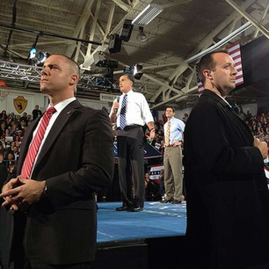 US Secret Service stand watch as Mitt Romney and Paul Ryan campaign in Celina Ohio #aponthetrail (AP Photo/Charles Dharapak) Photo: Charles Dharapak, Associated Press / AP