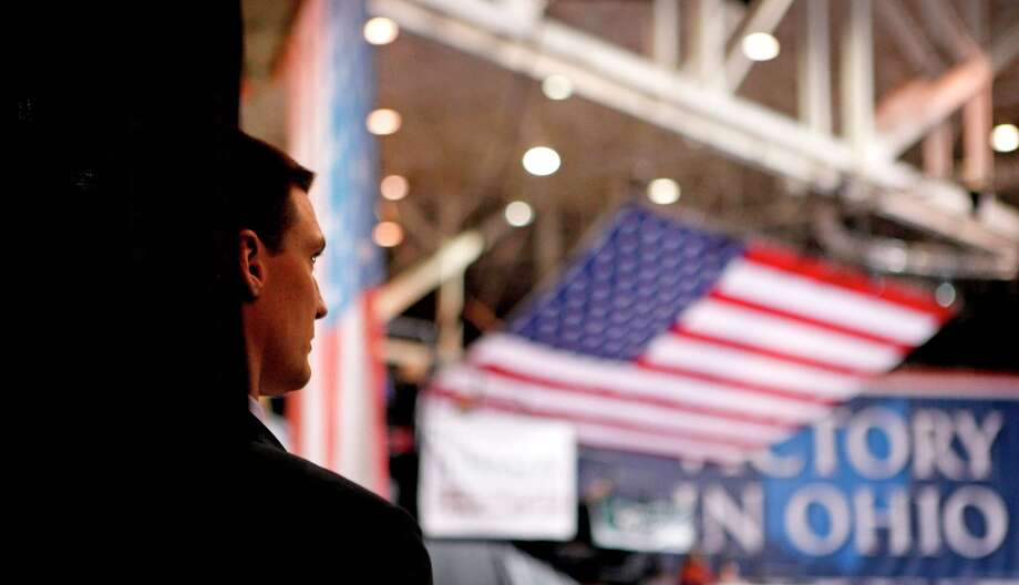 A secret service agent looks toward the stage before Republican presidential candidate, former Massachusetts Gov. Mitt Romney, appears to speak at a campaign event at the International Exposition Center, Sunday, Nov. 4, 2012, in Cleveland. (AP Photo/David Goldman) Photo: David Goldman, Associated Press / AP