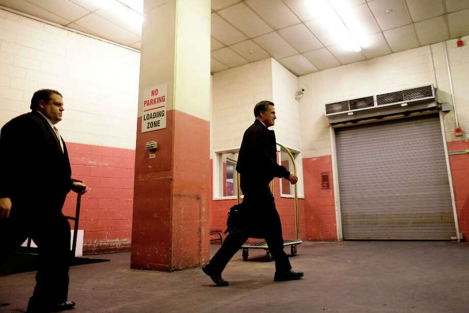 Republican presidential candidate and former Massachusetts Gov. Mitt Romney is accompanied by a U.S. Secret Service agent as he walks at a loading dock at his hotel in Norfolk, Va., Thursday, Nov. 1, 2012, as he finishes a day of campaigning. (AP Photo/Charles Dharapak) Photo: Charles Dharapak, Associated Press / AP