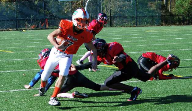 Senior Gators Quarterback Anthony Ferraro scrambles for a gain during a game against BANC. Photo: Contributed Photo