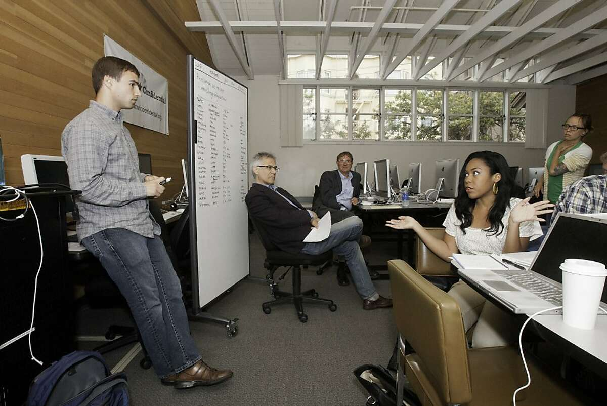 UC Berkeley lecturer Eric Simons and Tiffany Neely go over topics to cover with senior lecturer Bob Calo (center).