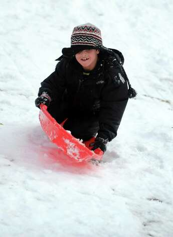 Sledding behind Derby Middle School Thursday, Nov. 8, 2012. Photo: Autumn Driscoll / Connecticut Post