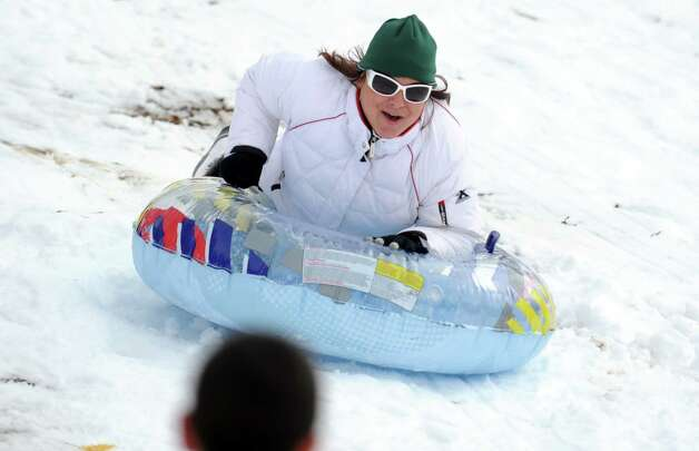 Krista Anroman, of Seymour, rides her sled down the hill behind Derby Middle School Thursday, Nov. 8, 2012. Photo: Autumn Driscoll / Connecticut Post