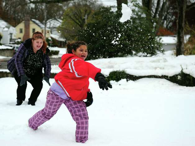 Lindsey Boscarino 12, left, and Jayda Cardiff, 10, fire back during a snowball fight Thursday, Nov. 8, 2012 in Derby, Conn. Photo: Autumn Driscoll / Connecticut Post
