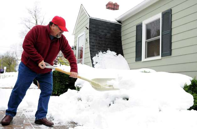 Joe Romano shovels his driveway Thursday, Nov. 8, 2012 in Derby, Conn. Photo: Autumn Driscoll / Connecticut Post