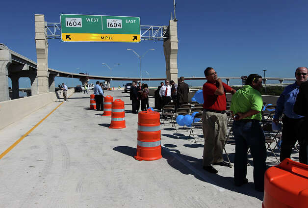 Guests leave from a ceremony that unveiled the new U.S. 281 North to Loop 1604 East and West Direct Connector on Thursday, Nov. 8, 2012. Construction that began 18 months ago to join the two highways has now been completed and ready to open to traffic. Photo: Kin Man Hui, San Antonio Express-News / © 2012 San Antonio Express-News
