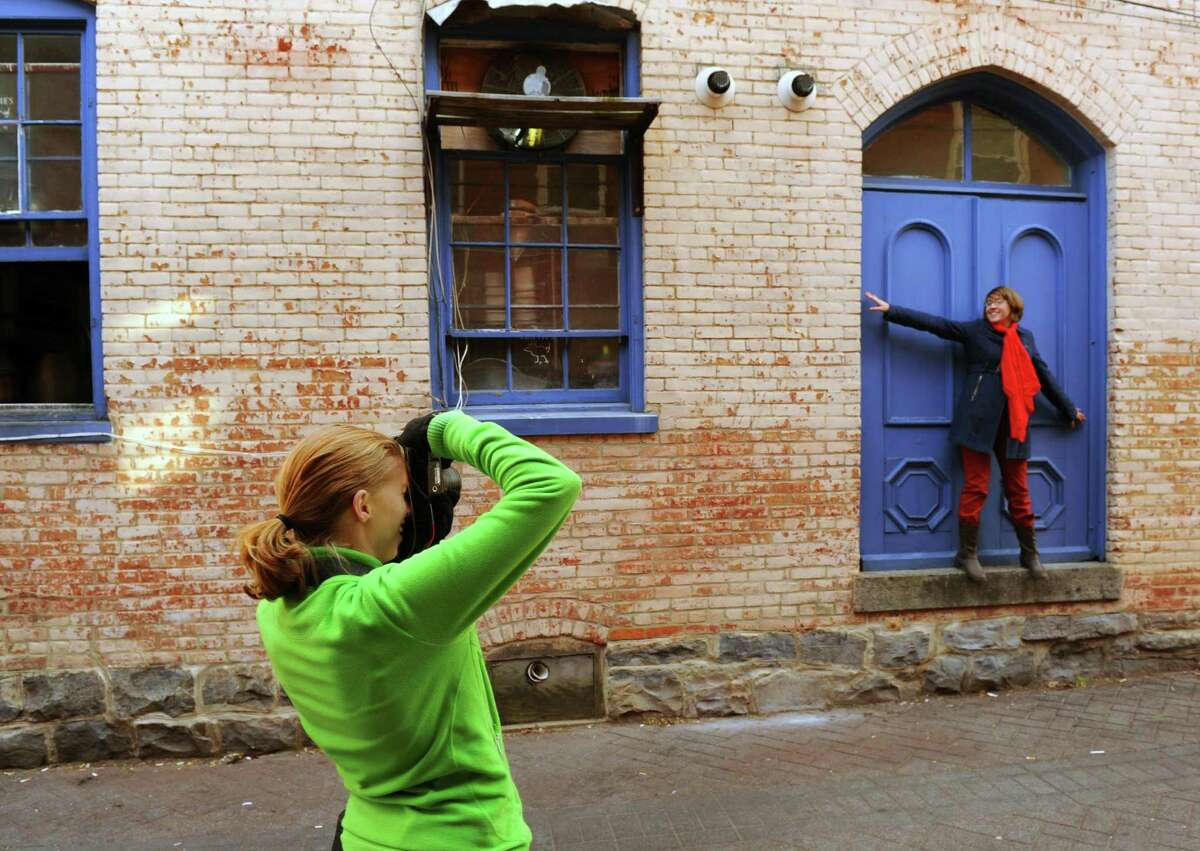 Photographer Lucy Schultz does a fall fashion photography shoot with model Leah Moore in Saratoga Springs, NY Thursday Nov. 8, 2012. (Michael P. Farrell/Times Union)
