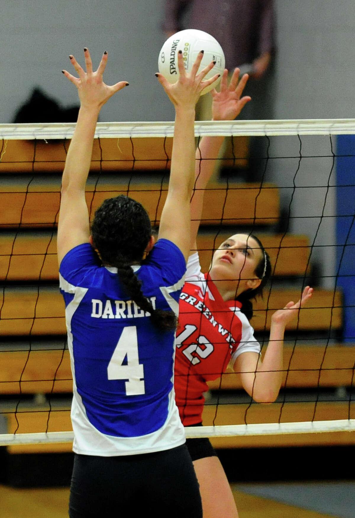 Greenwich's #12 Gennifer Pflug tries to send the ball past Darien's #4 Lauren Pryor, during FCIAC Girls' Volleyball Semi-final action in Fairfield, Conn. on Thursday November 8, 2012.