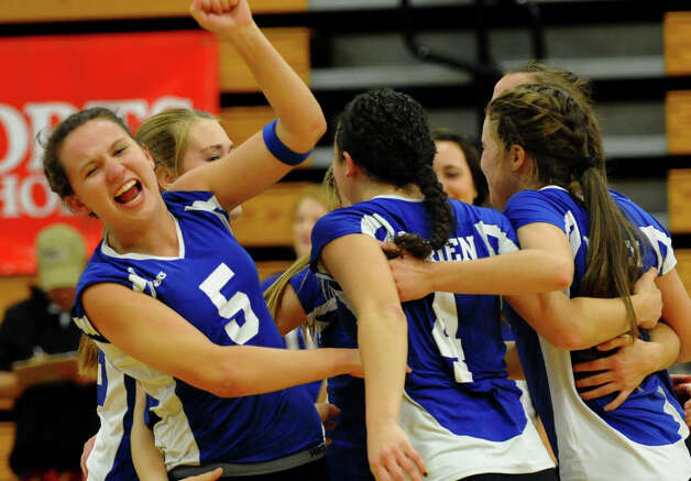 Darien's Riley Sousa pumps her fist in the air after the team defeated Greenwich, during FCIAC Girls' Volleyball Semi-final action in Fairfield, Conn. on Thursday November 8, 2012. Photo: Christian Abraham / Connecticut Post