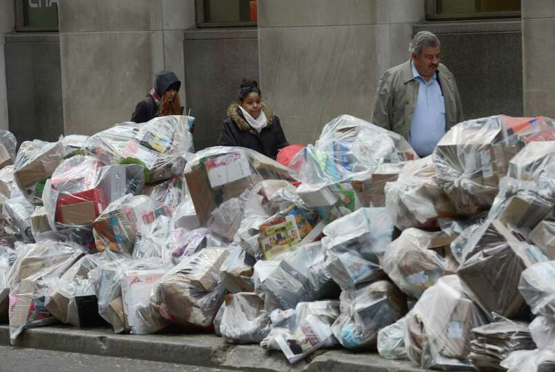 Recyclables piles up on William Street, one block from the New York Stock Exchange, Thursday, Nov. 8