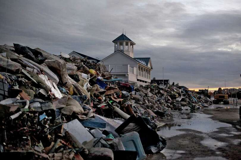 Debris from Superstorm Sandy is seen on a beach November 8, 2012 in Long Branch, New Jersey. Meanwhi