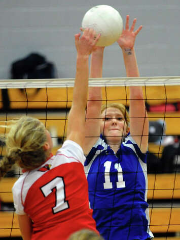 Darien's #11 Claire Naughton looks to stop  Greenwich's #7 Liza Johnson from getting the ball past, during FCIAC Girls' Volleyball Semi-final action in Fairfield, Conn. on Thursday November 8, 2012. Photo: Christian Abraham / Connecticut Post