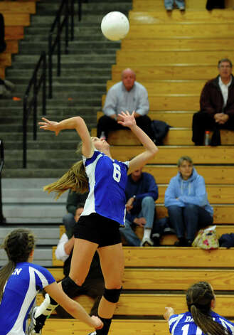 Darien's #6 Kelly Kosnik spikes the ball, during FCIAC Girls' Volleyball Semi-final action against Greenwich in Fairfield, Conn. on Thursday November 8, 2012. Photo: Christian Abraham / Connecticut Post