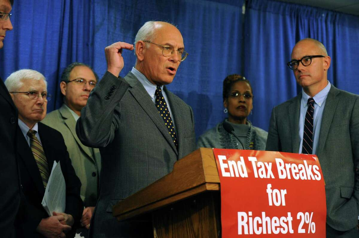 Congressman Paul Tonko and advocates call for Congress to end the Bush tax cuts for the wealthiest Americans and stop massive across-the-board budget cuts during a press conference at the Capitol in Albany, NY Thursday Nov. 8, 2012. (Michael P. Farrell/Times Union)