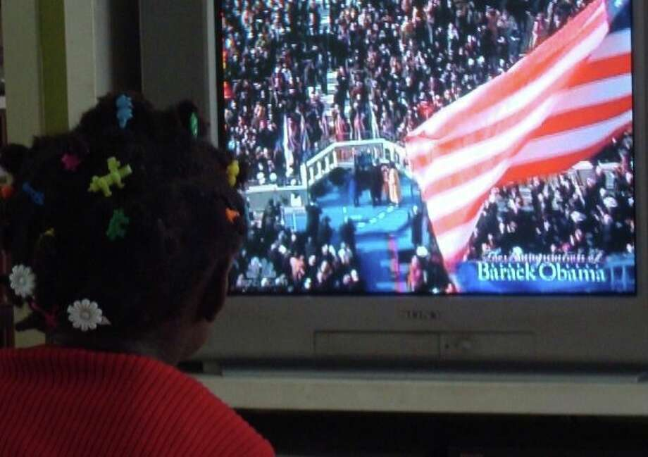 Mark McGuire's youngest daughter watched the 2009 inauguration of Barack Obama. (Donna Liquori)