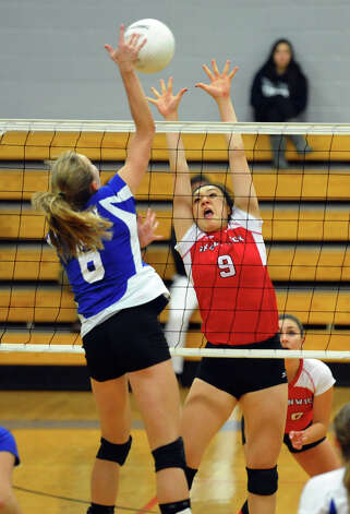 Darien's #6 Kelly Kosnik spikes the ball past Greenwich's #9 Mirei Kato, during FCIAC Girls' Volleyball Semi-final action in Fairfield, Conn. on Thursday November 8, 2012. Photo: Christian Abraham / Connecticut Post