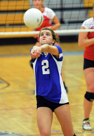 Darien's #2 Kathleen Burke bumps the ball, during FCIAC Girls' Volleyball Semi-final action against Greenwich in Fairfield, Conn. on Thursday November 8, 2012. Photo: Christian Abraham / Connecticut Post