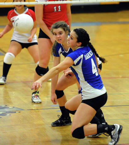 Darien's #4 Lauren Taylor tries to intercept the ball, during FCIAC Girls' Volleyball Semi-final action against Greenwich in Fairfield, Conn. on Thursday November 8, 2012. Photo: Christian Abraham / Connecticut Post