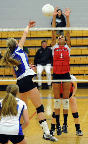 Darien's #6 Kelly Kosnik spikes the ball past Greenwich's #1 Jennie Cespedes, during FCIAC Girls' Volleyball Semi-final action in Fairfield, Conn. on Thursday November 8, 2012. Photo: Christian Abraham / Connecticut Post
