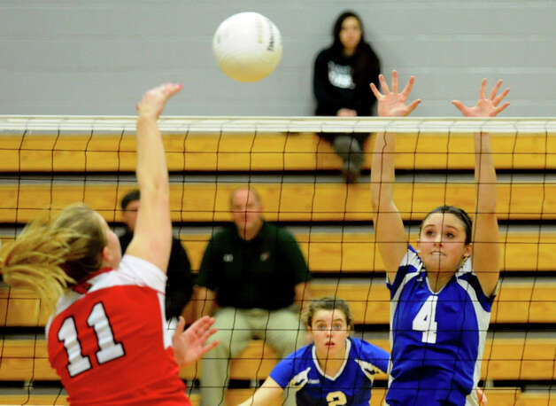 Darien's #4 Lauren Taylor, right, looks to block Greenwich's #11 Ebba Mark, during FCIAC Girls' Volleyball Semi-final action in Fairfield, Conn. on Thursday November 8, 2012. Photo: Christian Abraham / Connecticut Post