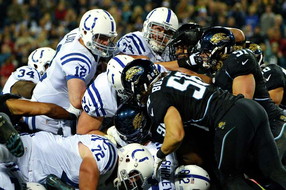Indianapolis Colts quarterback Andrew Luck (12) pushes his way into the end zone to score a touchdown against the Jacksonville Jaguars during the second quarter of an NFL football game, Thursday, Nov. 8, 2012, in Jacksonville, Fla. (AP Photo/Phelan M. Ebenhack) Photo: Phelan M. Ebenhack, Associated Press / FR121174 AP