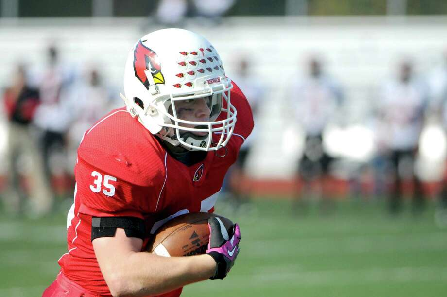"Greenwich High School senior running back Mark Bernstein caught two touchdown passes and ran for another as the Cardinals crushed the Hilltoppers of Bridgeport Central 56-6 on Homecoming Day at GHS.  ""The offensive line was opening up huge holes and really did a great job,"" Bernstein said, after the game. Photo: Keelin Daly / Stamford Advocate Freelance"
