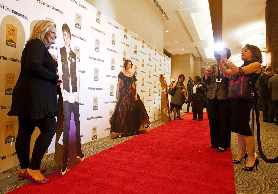 "At the event, dubbed ""An Evening with the Stars,"" attendees were able to pose with cutouts of celebrities like Justin Bieber and Catherine Zeta-Jones."