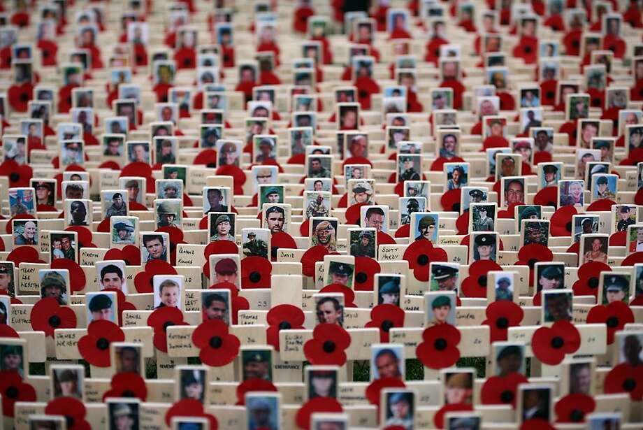A sea of crosses bearing pictures of soldiers killed in Afghanistan is placed in the Royal British Legion Field of Remembrance at Westminster Abbey on November 8, 2012 in London, England. Hundreds of small crosses bearing a poppy have been planted in a Field of Remembrance in a  tribute to British servicemen and women who have lost their lives in conflict. Photo: Peter Macdiarmid, Getty Images