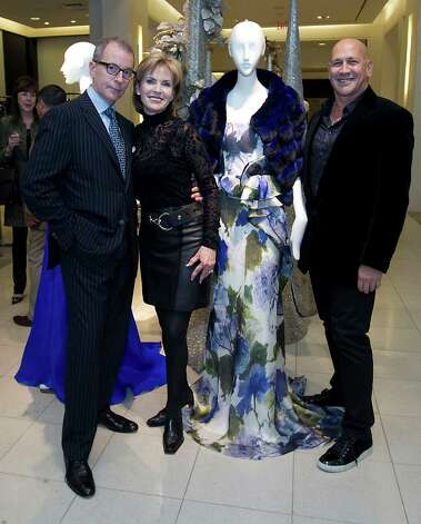 Saks Fifth Avenue Vice President and General Manager Terry Zmyslo left, Victory President Pam Jones and Fashion Designer Carmen Marc Valvo during the Houston Chronicle's Style launch party at Saks Fifth Avenue Galleria Thursday, Nov. 8, 2012, in Houston.   