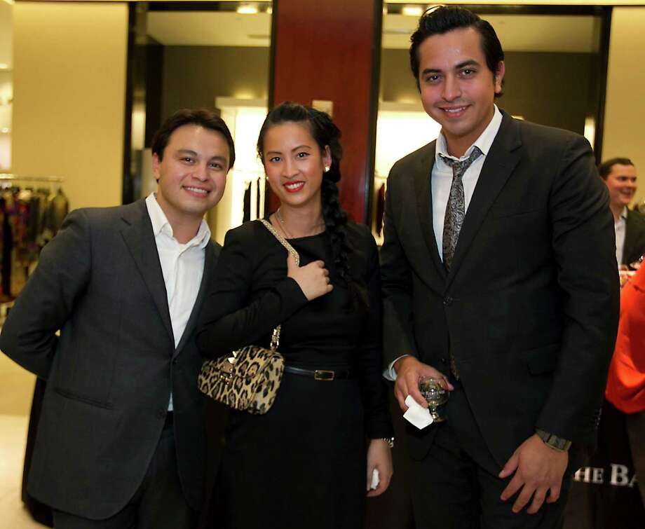 Valentino's Ronald Mazariegos left, Gwen Le and Christian Garcia at the Houston Chronicle's Style launch party at Saks Fifth Avenue Galleria Thursday, Nov. 8, 2012, in Houston.   