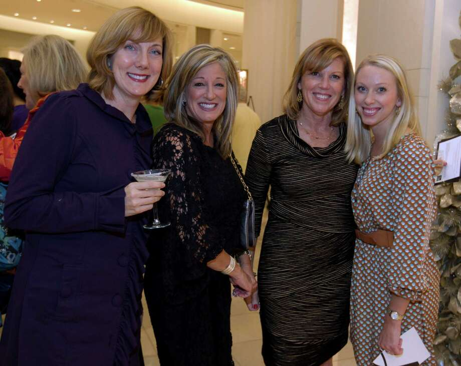 Mary Ward left, Kelly Siler, Gigi Harbison and her daughter Kate Harbison during the Houston Chronicle's Style launch party at Saks Fifth Avenue Galleria Thursday, Nov. 8, 2012, in Houston.   