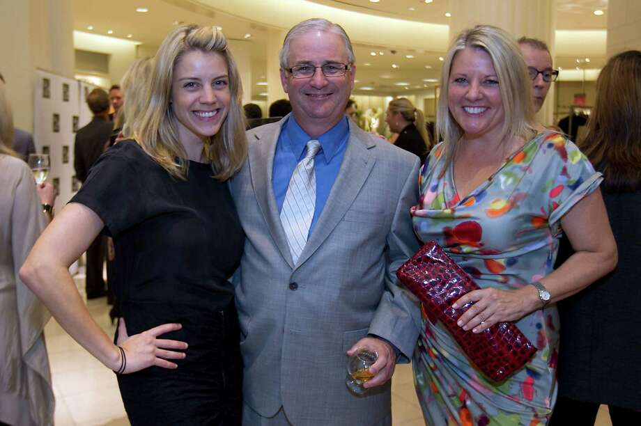 The Houston Chronicle's Jody Schmal left, Steve Proctor and Melissa Aguilar during the Houston Chronicle's Style launch party at Saks Fifth Avenue Galleria Thursday, Nov. 8, 2012, in Houston.   