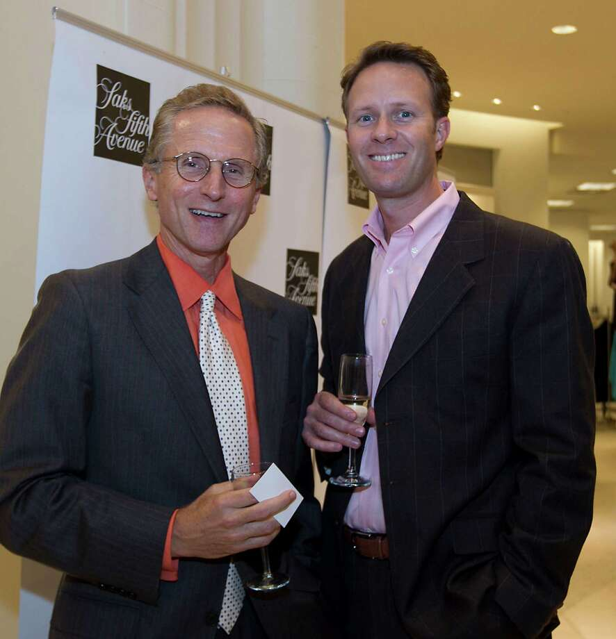 Lou DeLone left, and the Houston Chronicle's Jay Janecek during the Houston Chronicle's Style launch party at Saks Fifth Avenue Galleria Thursday, Nov. 8, 2012, in Houston.   