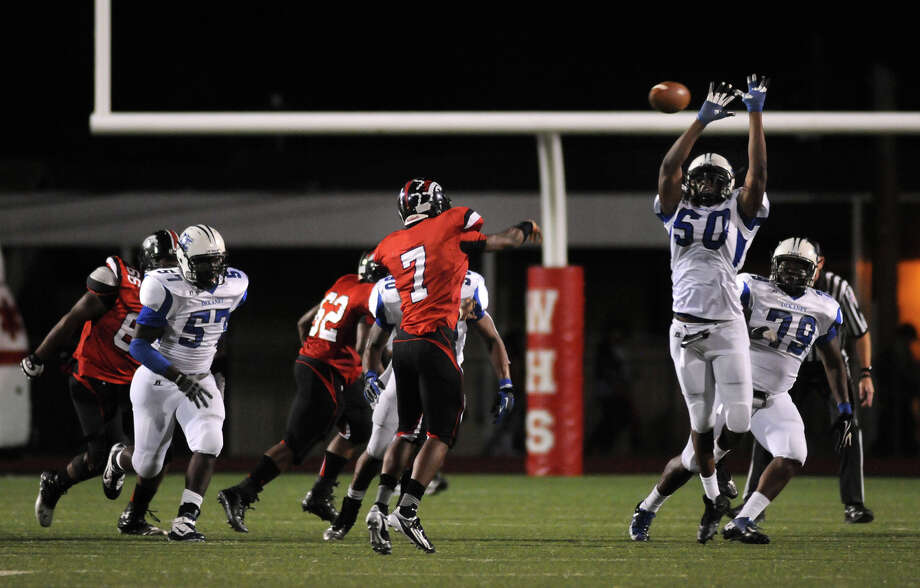 Westfield junior quarterback Courtland Greenwood (#7) throws past leaping Dekaney junior defensive lineman Isadore Outing (#50) during their game at Leonard George Stadium on Thursday. Photo by Jerry Baker Photo: Jerry Baker, For The Chronicle
