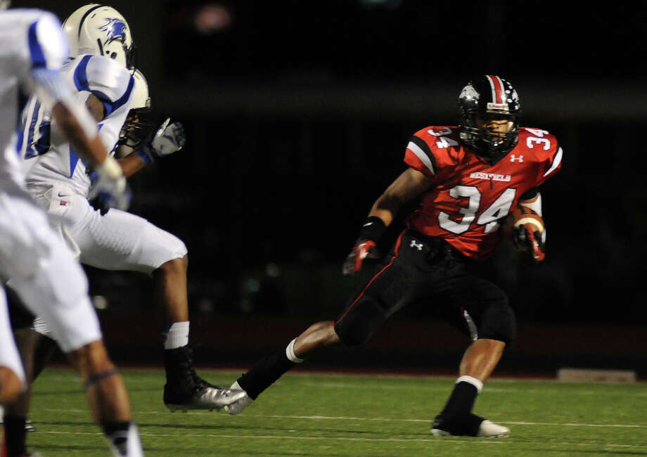 Westfield 28, Dekaney 14Westfield senior running back Emmitt Raleigh (#34) looks for yardage against the Dekaney defense during their game at Leonard George Stadium on Thursday. Photo by Jerry Baker Photo: Jerry Baker, For The Chronicle